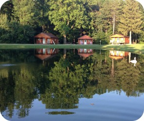 Cabins in pond reflection